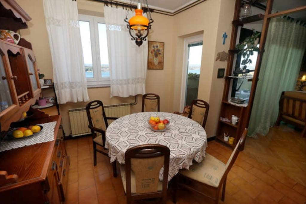 A spacious dining room with a kitchen