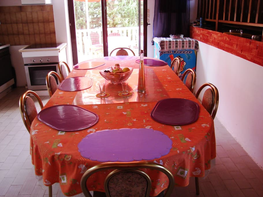 a big table in the kitchen