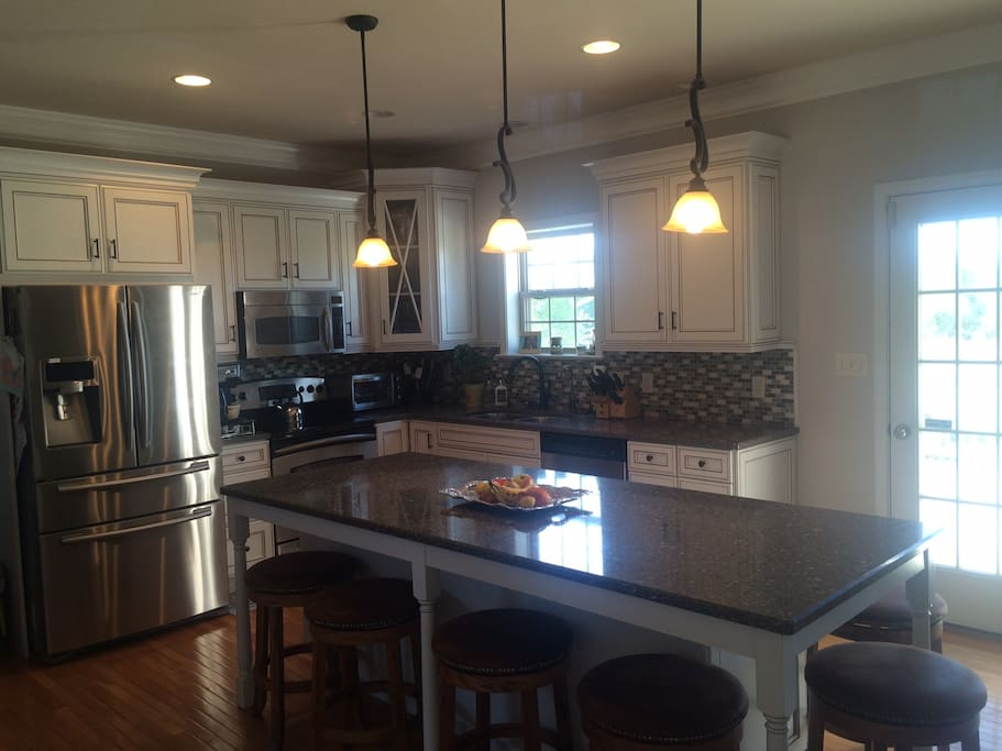 Quarts island that seats 6.  Stainless steel appliances. Dishwasher, microwave and fully equipped for meal prep and entertaining.