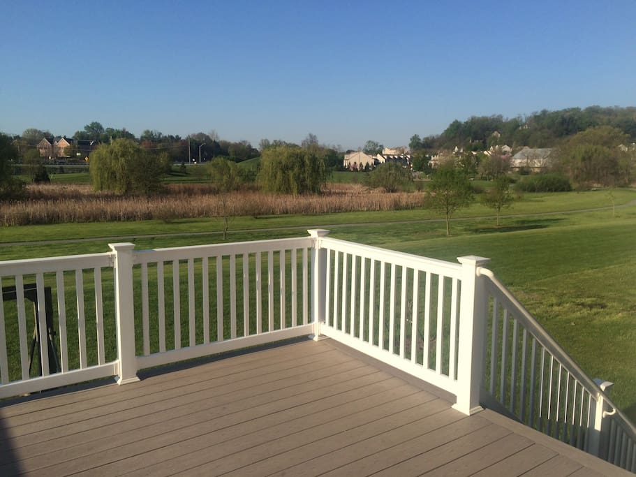 Deck with views of walking trails and community park/creek/playground.