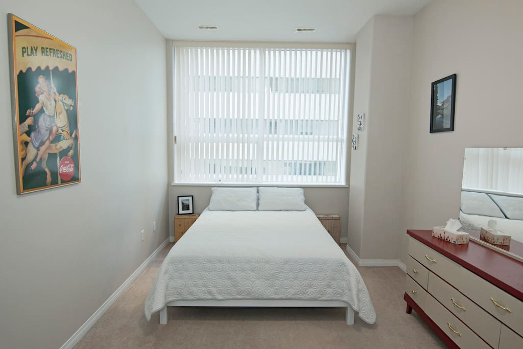 Master Bedroom - Queen size bed. Spacious carpeted room with large windows and high ceilings. Closet space, extra blanket provided.
