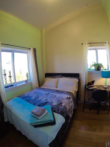 2ND Bedroom - The Room is furnished with a full sized bed and a small office table and chair