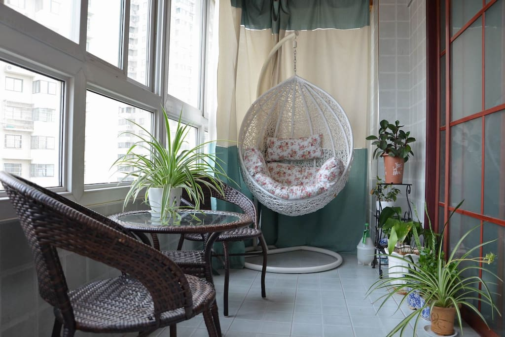 This is my balcony with many plants and a lot of sunshine