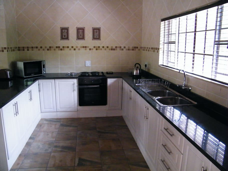 Fully equipped kitchen. Including dishwasher and washing machine
