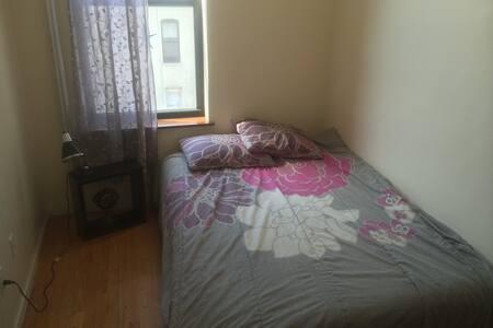 Clean NY Bedroom near many subways!