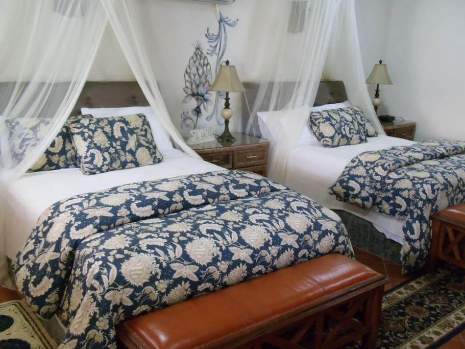 Double-queen Master Suite with living room and kitchenette & full bath