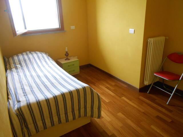 Zona notte con letto + eventuale altro letto aggiuntivo