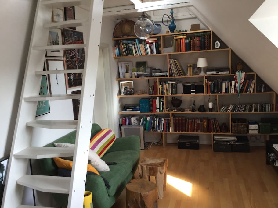 Our cozy living room. Staircase goes up to a small loft, where there is space for an extra mattress.