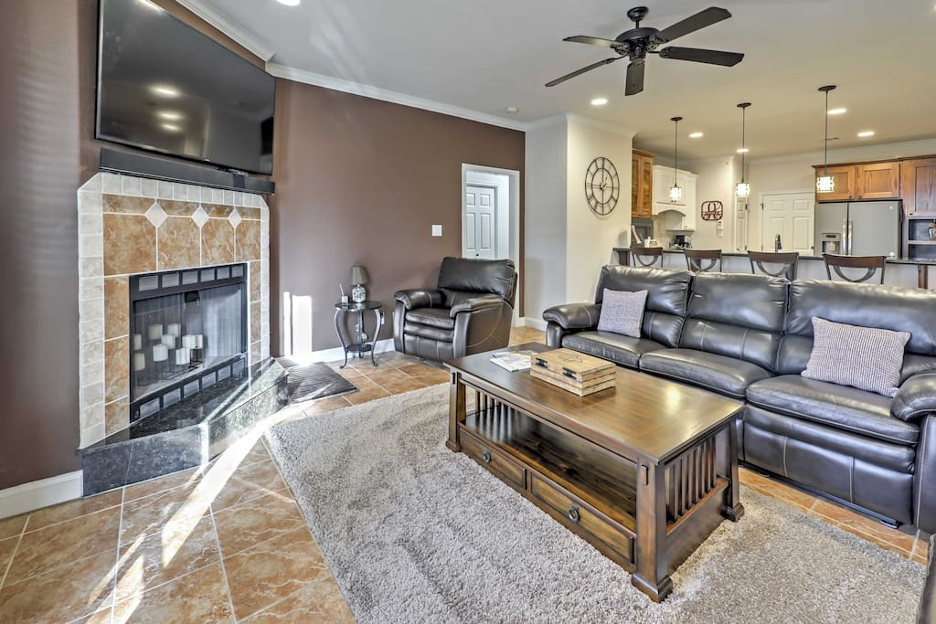 Watch Aggie games and TV shows on the flat-screen cable TV in the living room.