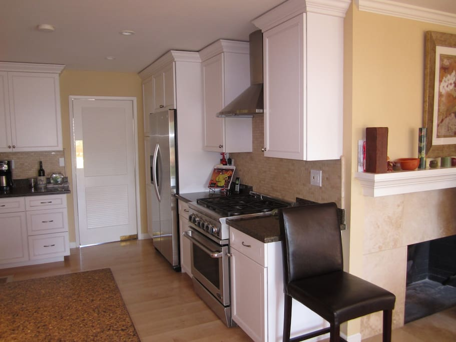 Modern renovated kitchen with chef's 5 burner gas range.