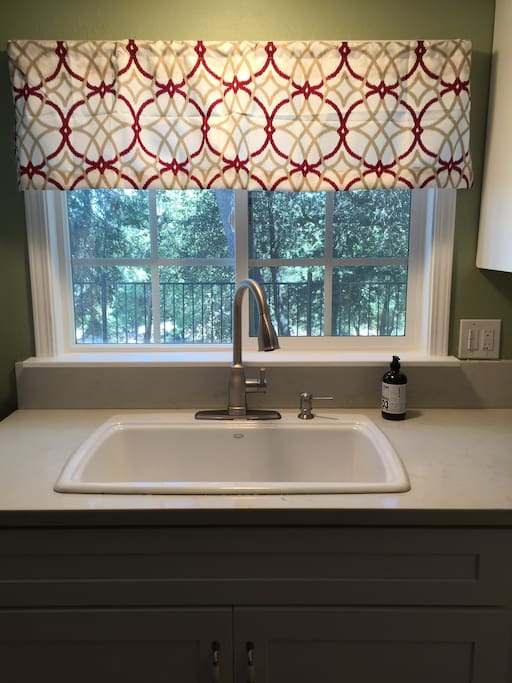 The kitchen sink has a great view of the lush trees around this home.