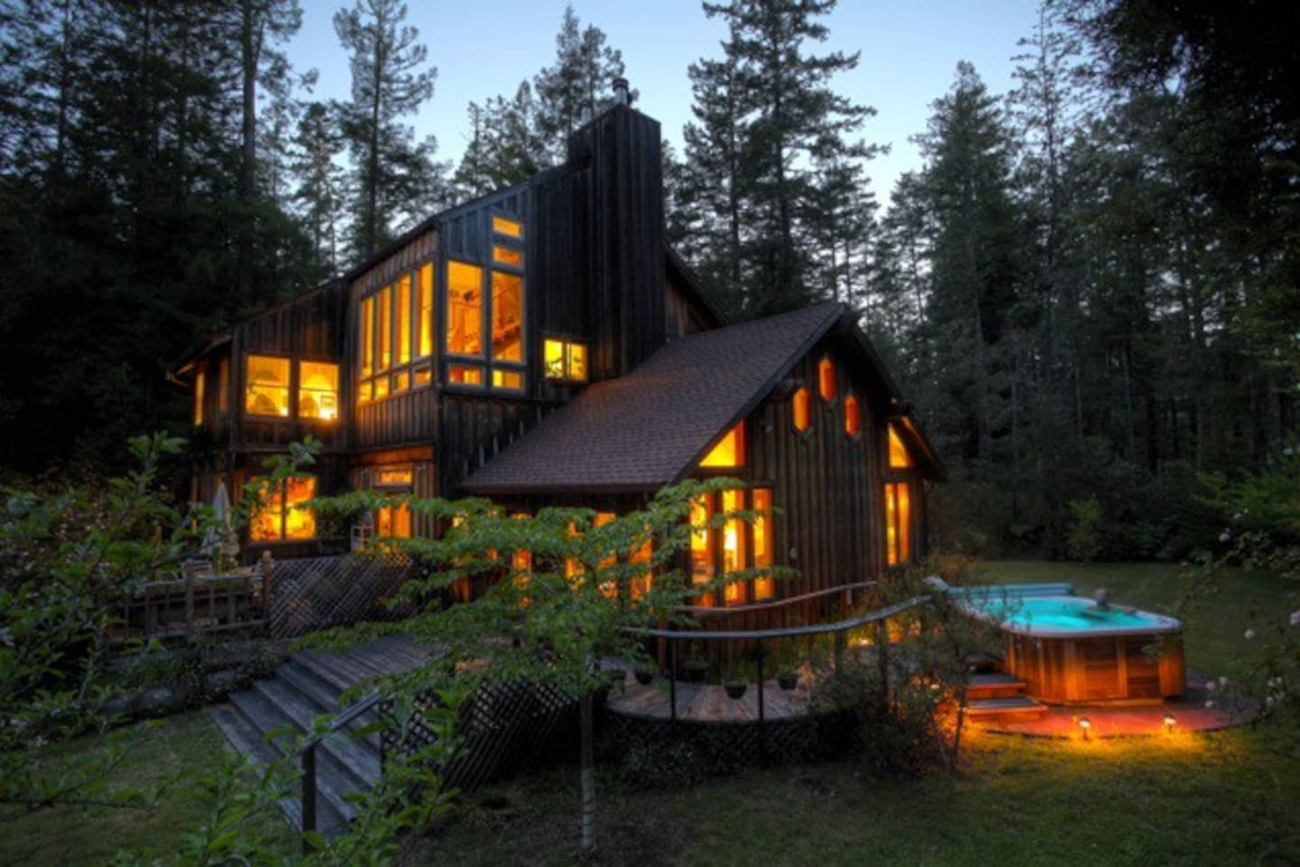 The House and Hot Tub  At Night. Your rooms are up there on the second floor of the house.