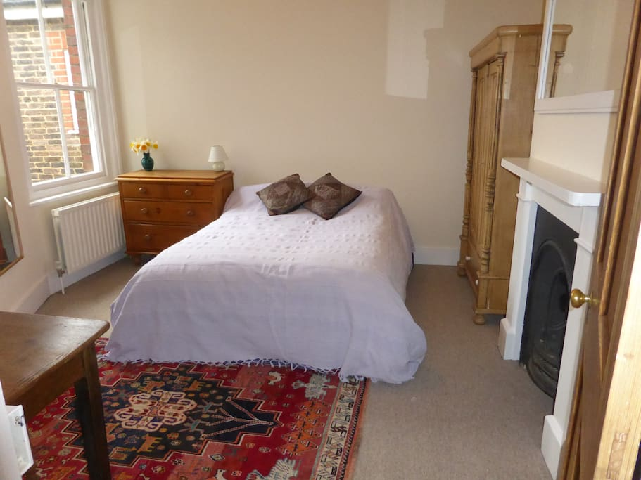 A spacious double room with original Victorian features and plenty of storage