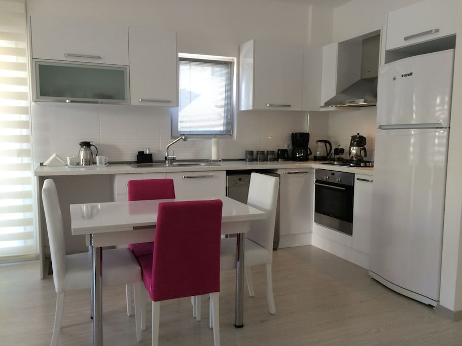 6-SEATER DINING TABLE INTHE KITCHEN AREA, 6 PEOPLE TABLEWARE AND COOKING SETS ARE AVAILABLE.