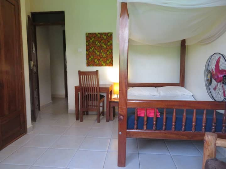 Double room with shared bathroom at Bikeventures