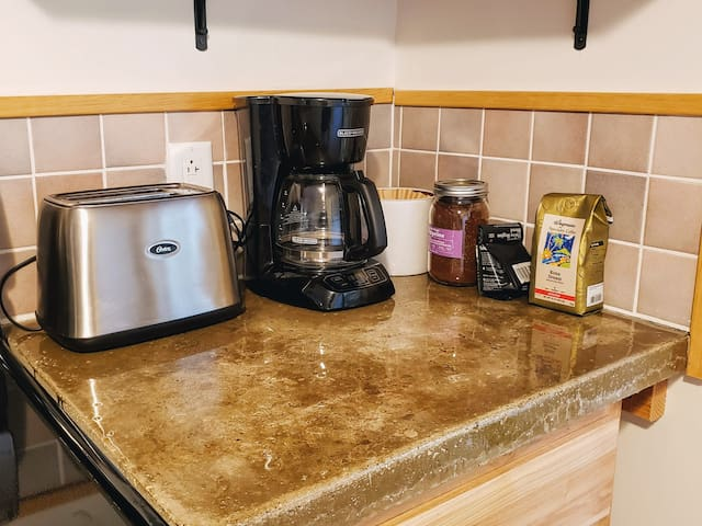 The house is stocked with several coffee choices, including local Rothrock coffee.
