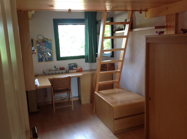 Room with two single beds in mezzanine