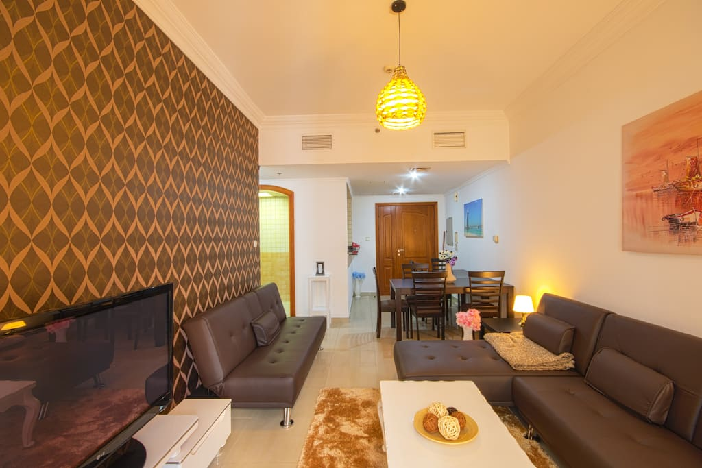 Large living room with 3 sleep sofas and a large dining table for 9 persons.