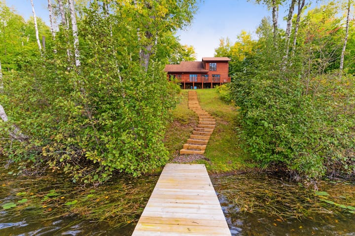 Beautiful lakefront cabin w/ a private dock, firepit, & large yard