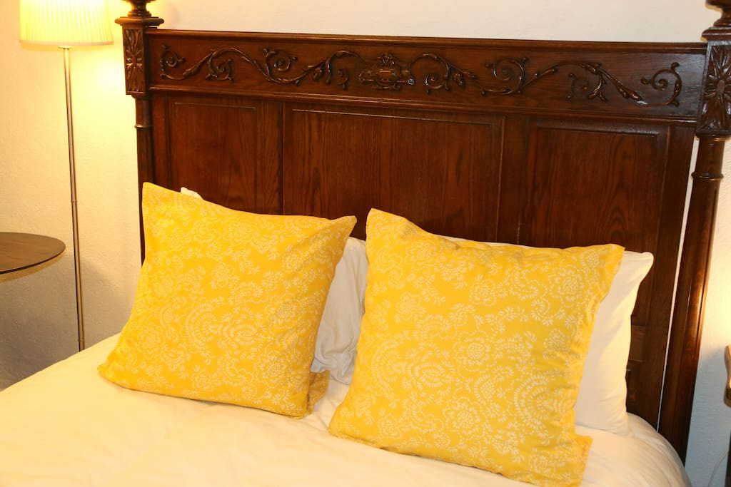 Antique double bed with new linens