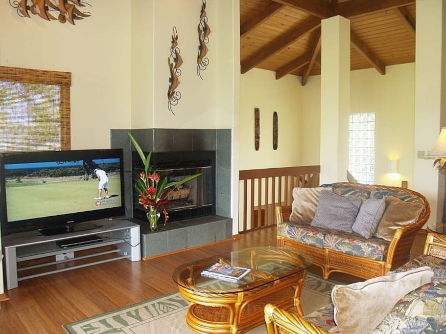 Great room with large screen TV and gas fireplace
