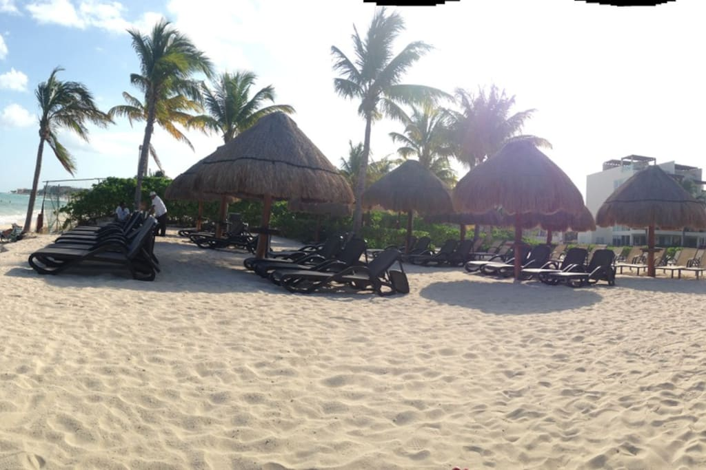 PRIVATE BEACH IS RIGHT OUTSIDE MY DOOR WITH BEACH CLUB SERVICE.