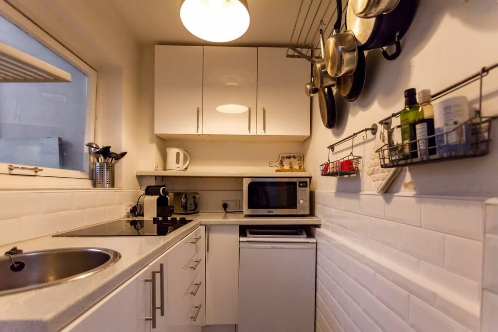 A kitchen with plenty of appliances...