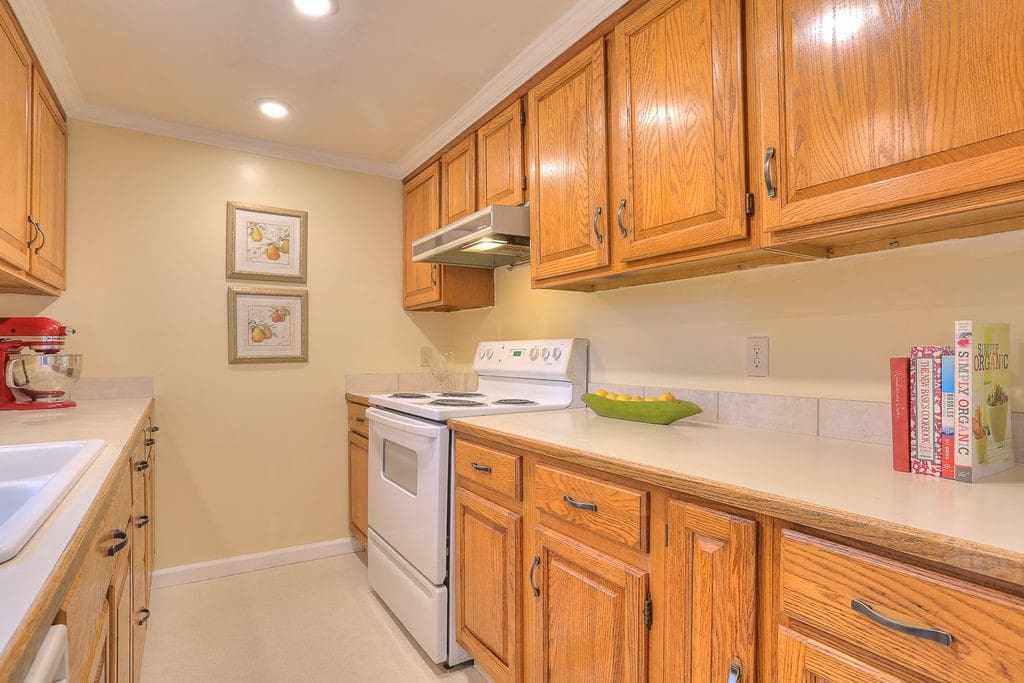 A full kitchen with stove, sink, refrigerator ready for you.