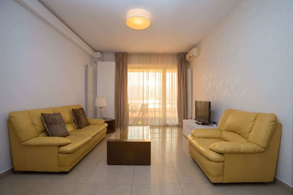 The living room is open space, equipped with sofa and 2 armchairs premium leather.