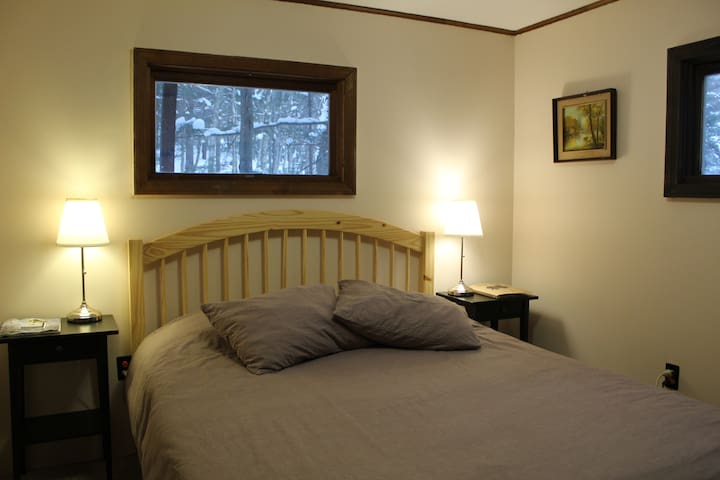 The Goat Run Room, a cute cozy space, with a warm rug at your feet and a big comforter to keep you warm at night!