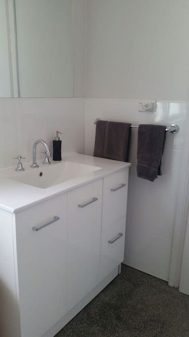 Your bathroom also contains the laundry and is off the back verandah.