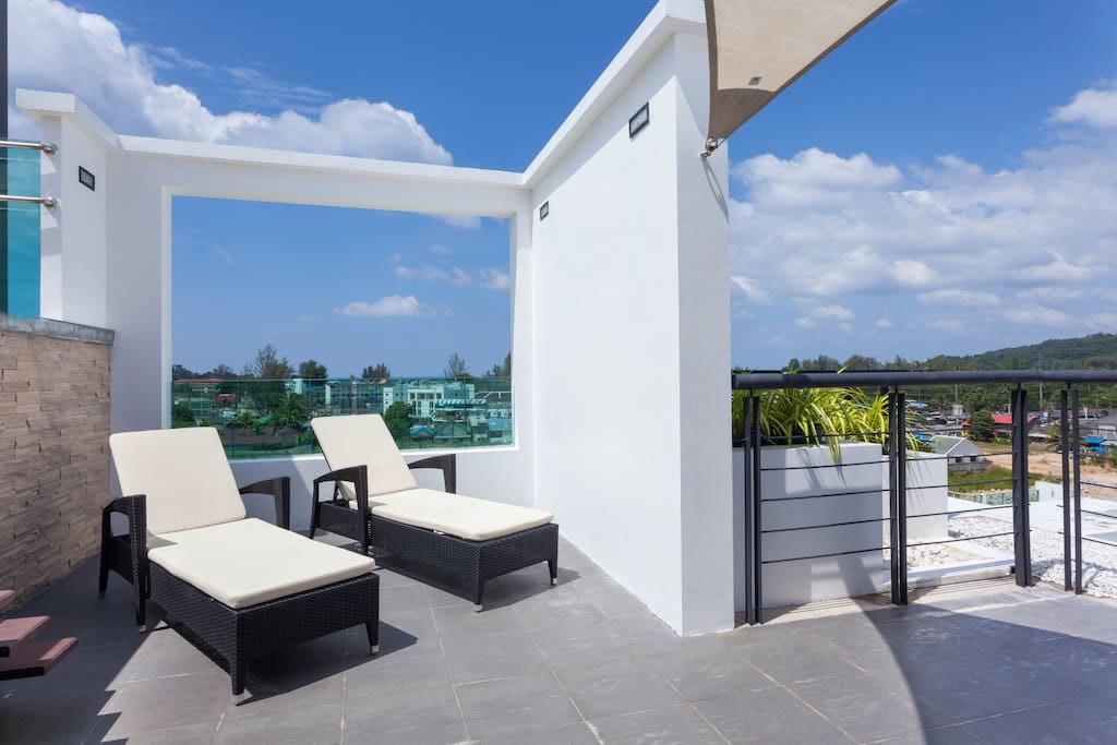 Sundeck with outdoor furniture and dining space