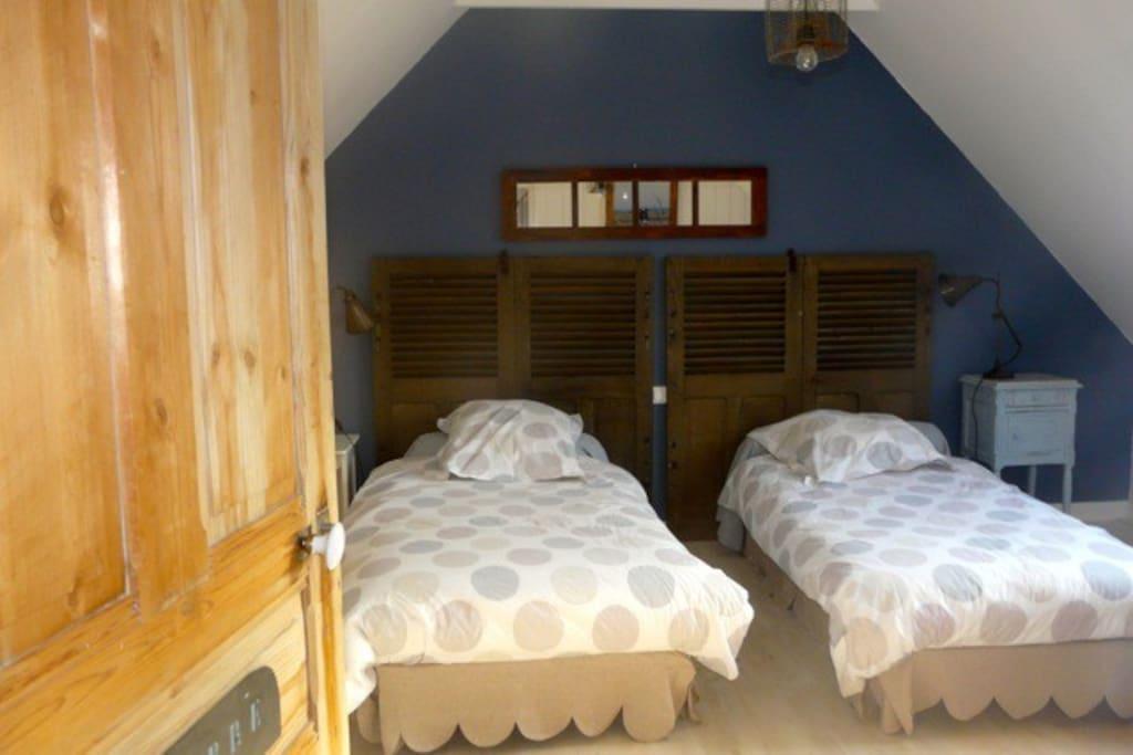 Chambre 2 lits transformables en 1 lit 180/200