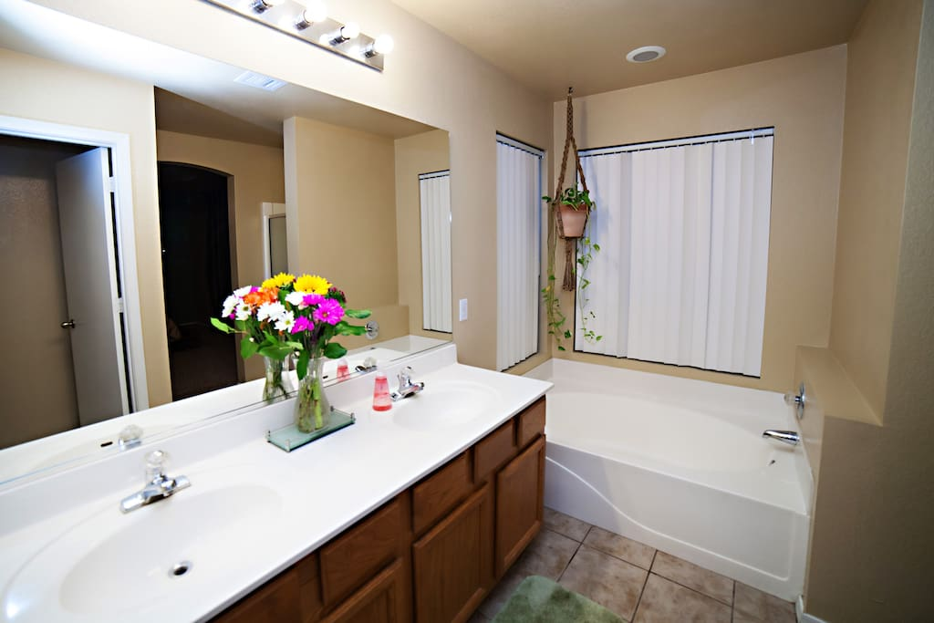 In-suite private bathroom with dual sinks and large soaking tub.