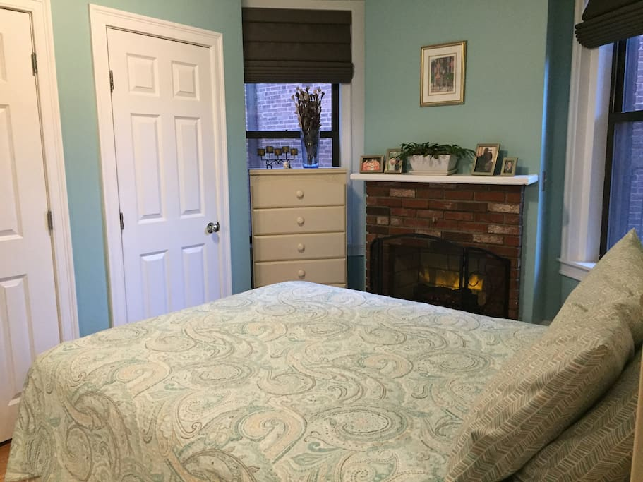 Comfortable queen bed with plenty of pillows. Plus room darkening shades.