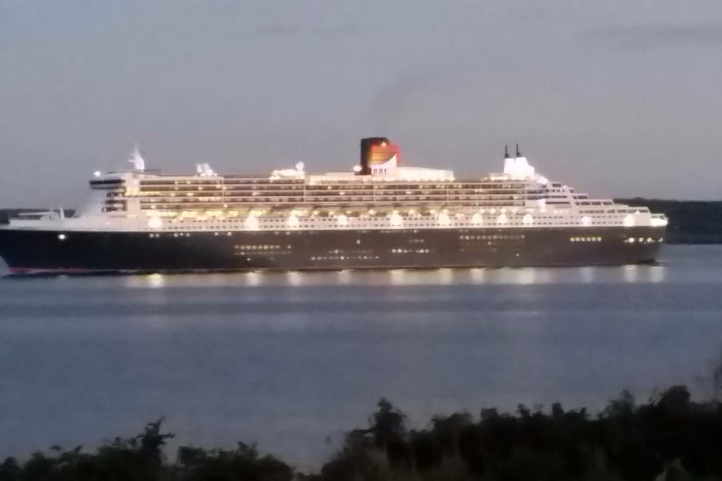 Watch the Cruz ships and the Newfoundland ferry as you relax on the front patio. This ship is called the Queen Mary .