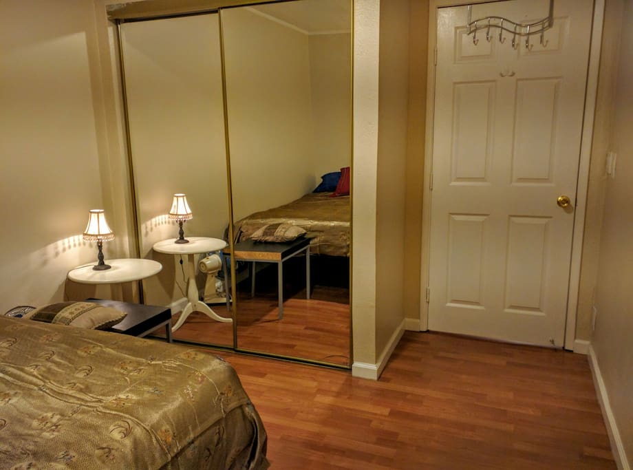 Reverse View of the bedroom with closet space and mirror