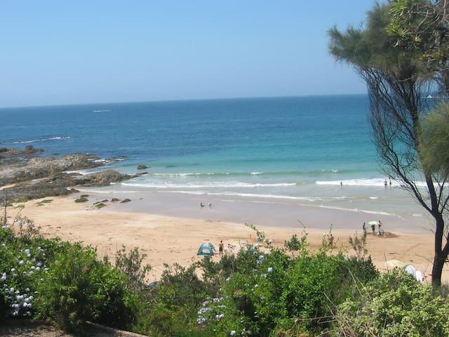 Breathtaking ocean, beach and bush views.