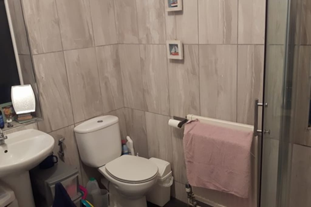The shared WC/Bathroom is spacious including a walking in shower to the right and a bath to the left.