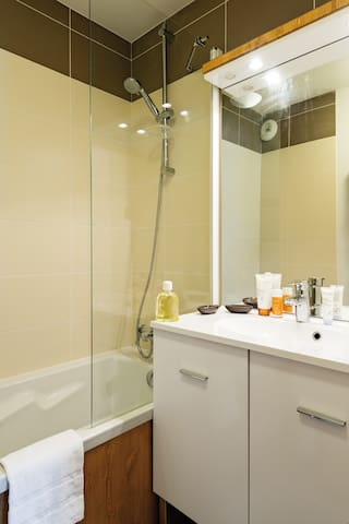 Get ready for your day in the lovely bathroom.