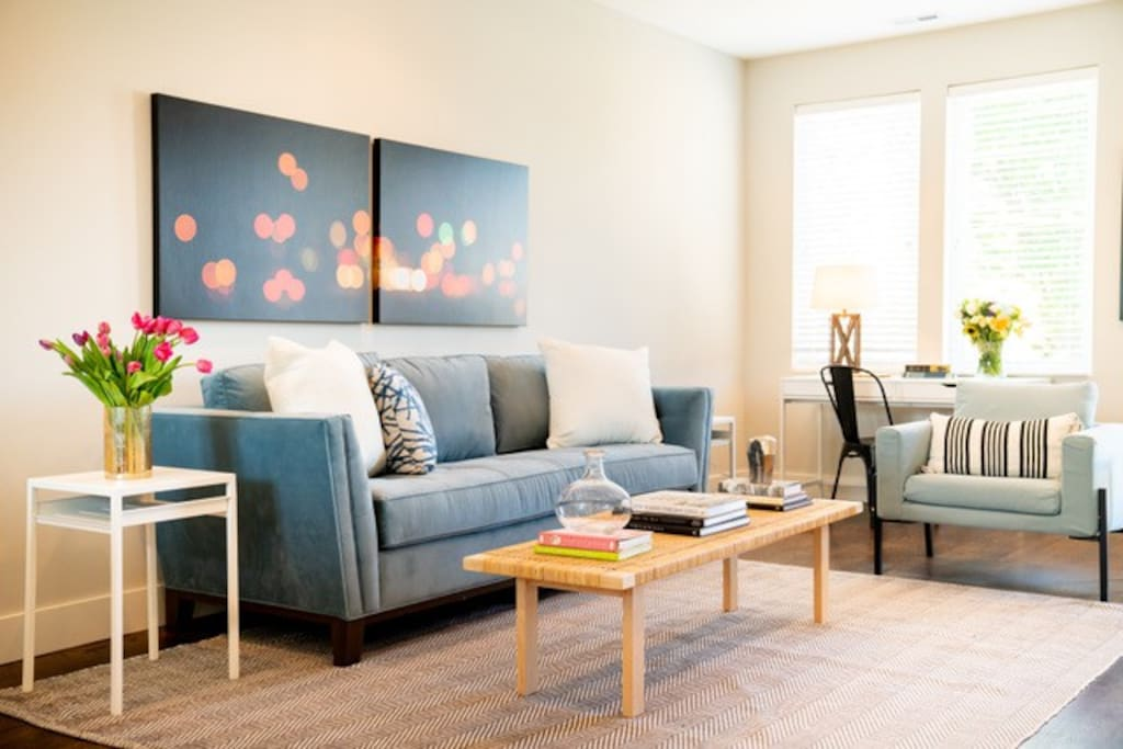 comfy living room with queen sleeper sofa