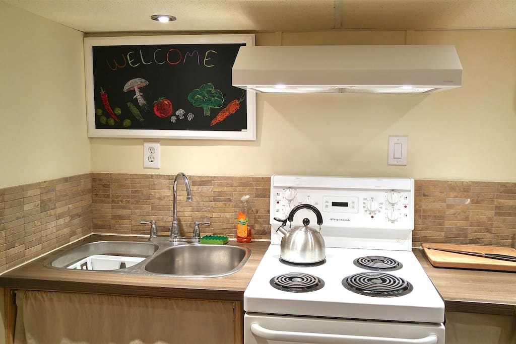 Fully equipped kitchen with stove, fridge and toaster.
