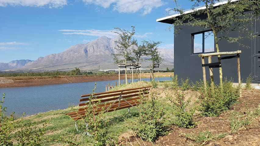 Trendy private container home! Riverstone House.