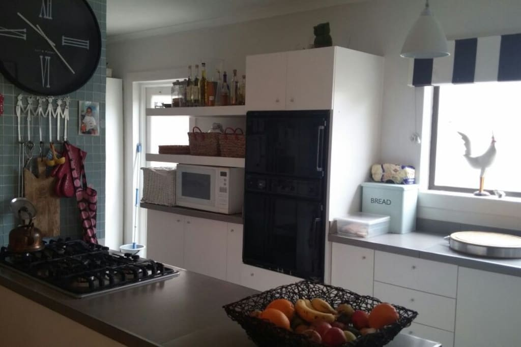 Kitchen with gas hob and double level electric oven and scullery. Microwave, double fridge/freezer with built-in ice maker and water dispenser, dishwasher etc. Chest freezer
