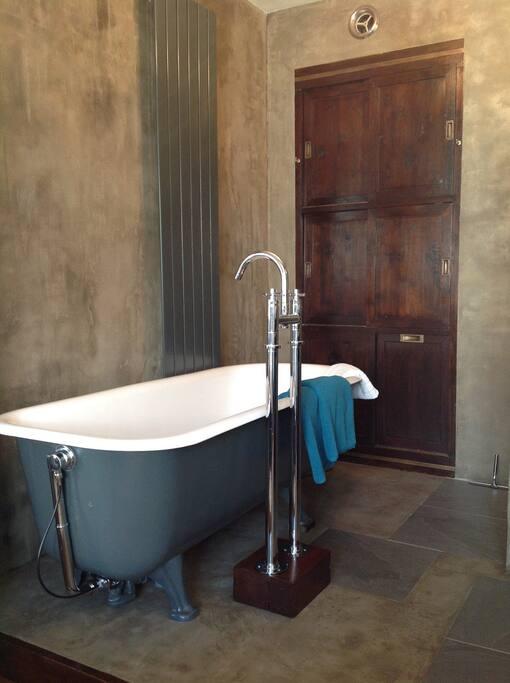 Bath in open bathroom