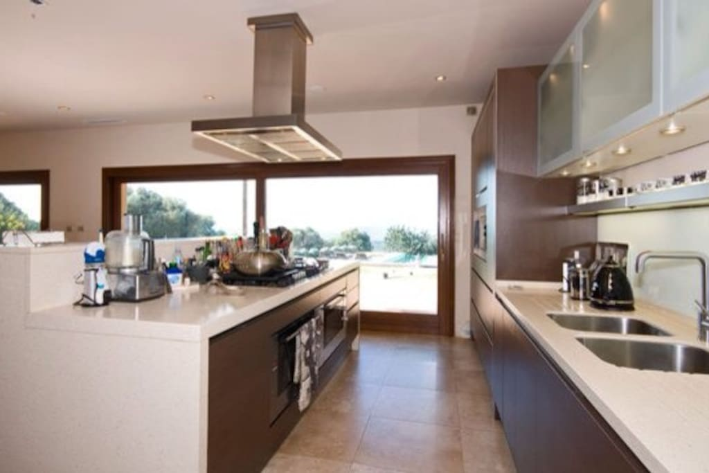 Modern kitchen with 2 large ovens and 8 ring gas hob