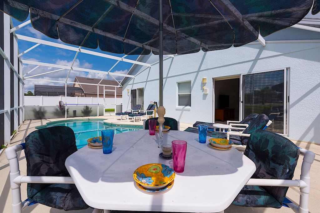 The pool deck is the perfect place to relax, play and dine.