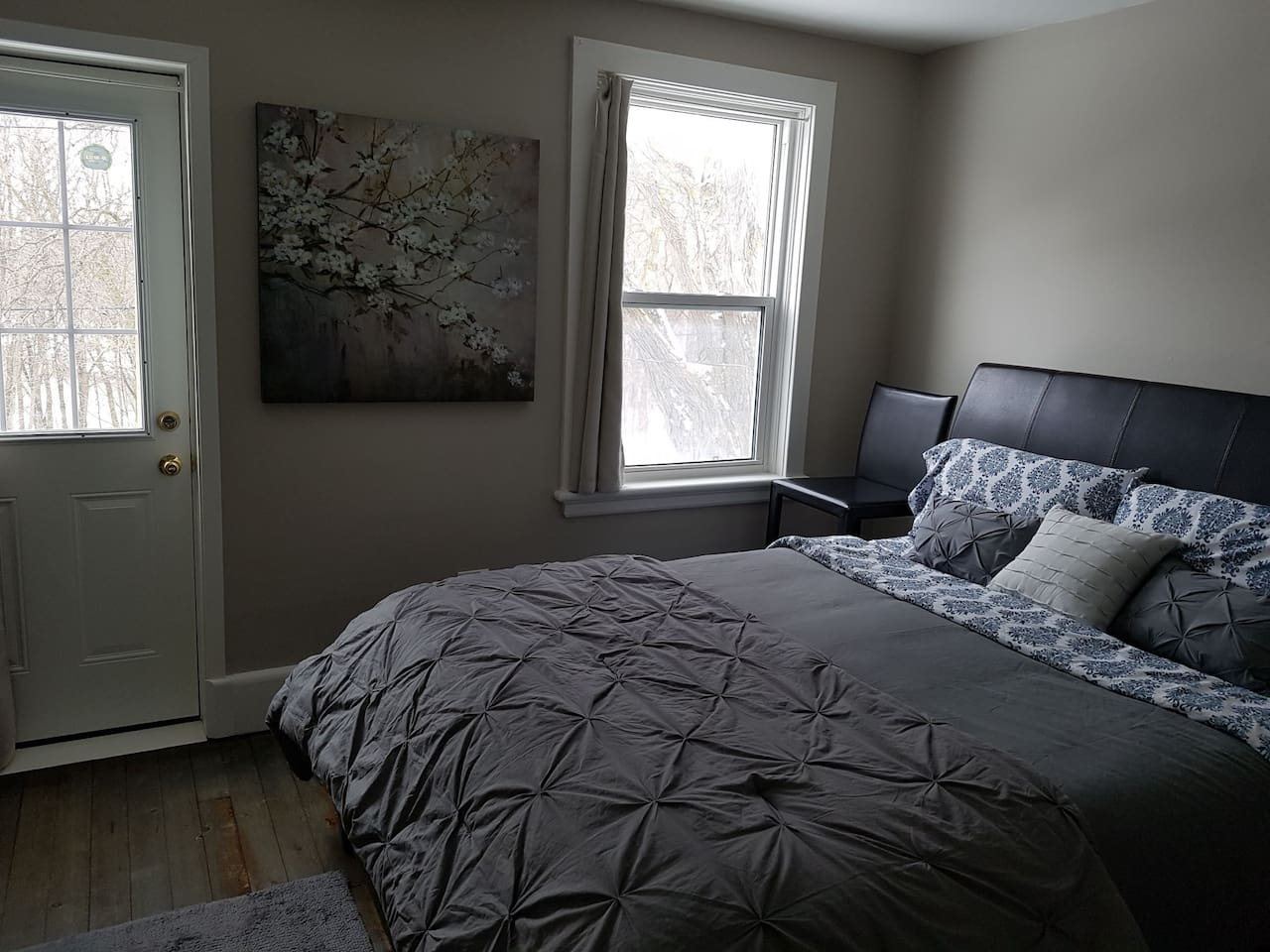 three large cozy bedrooms featuring Queen size beds and closets!