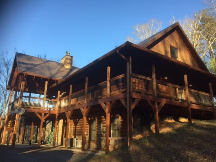 log home has wrap around decking