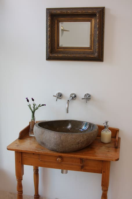 Antique washstand with stone basin.